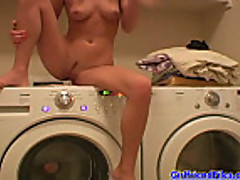 Teen riding washing machine