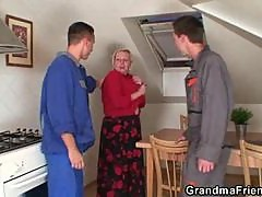 Busty granny lets handymen have her
