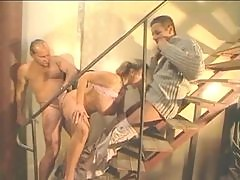 Young curvy girl fucked by two guys on the stairs