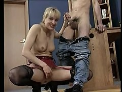 Blonde mom eagerly strokes his shaft