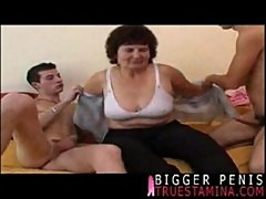 Chubby mom gets drilled filled by 2 young cocks 1