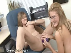 Blonde lesbian couple uses a dildo at office