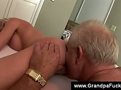 Deepthroating blonde gags on old cock