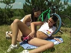 Teenage girls have lesbian sex outdoors